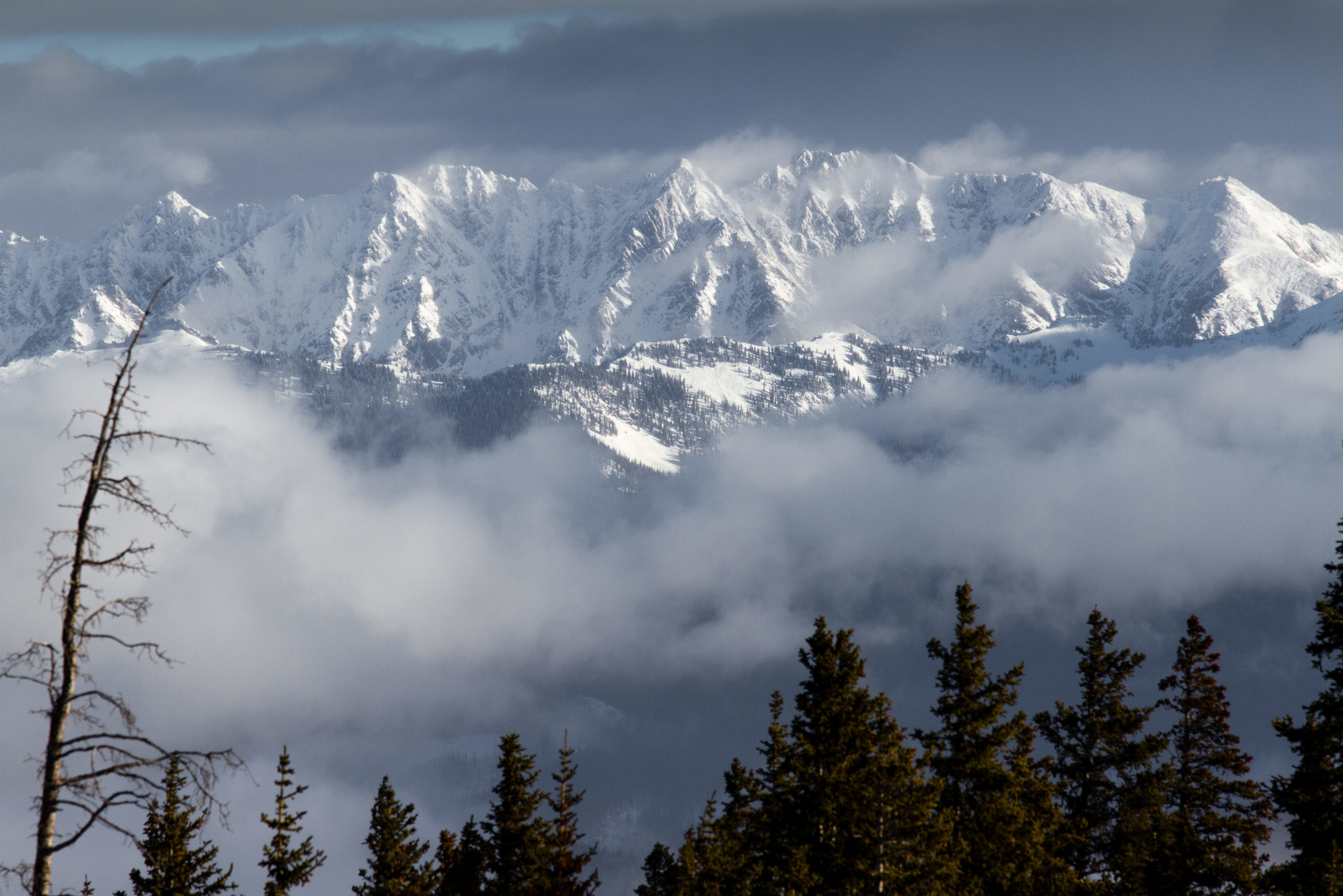 The Gore Range shining through the clouds as seen from Beaver Creek during the Birds of Prey ski races. 5, December 2014