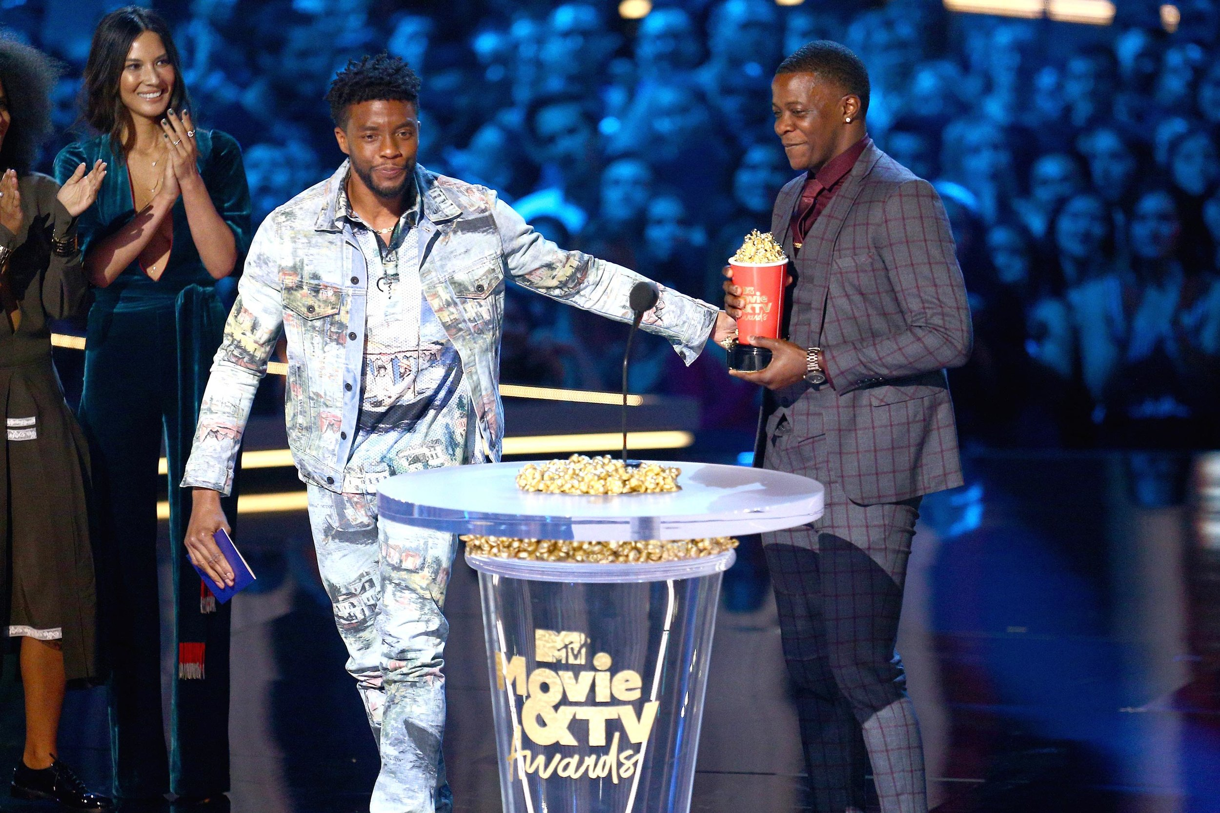 Winner Chadwick Boseman gives his trophy to Waffle House hero James Shaw, Jr.