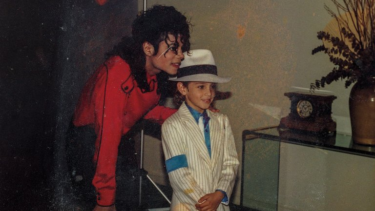 Jackson with 7-year-old Wade in the early 90s