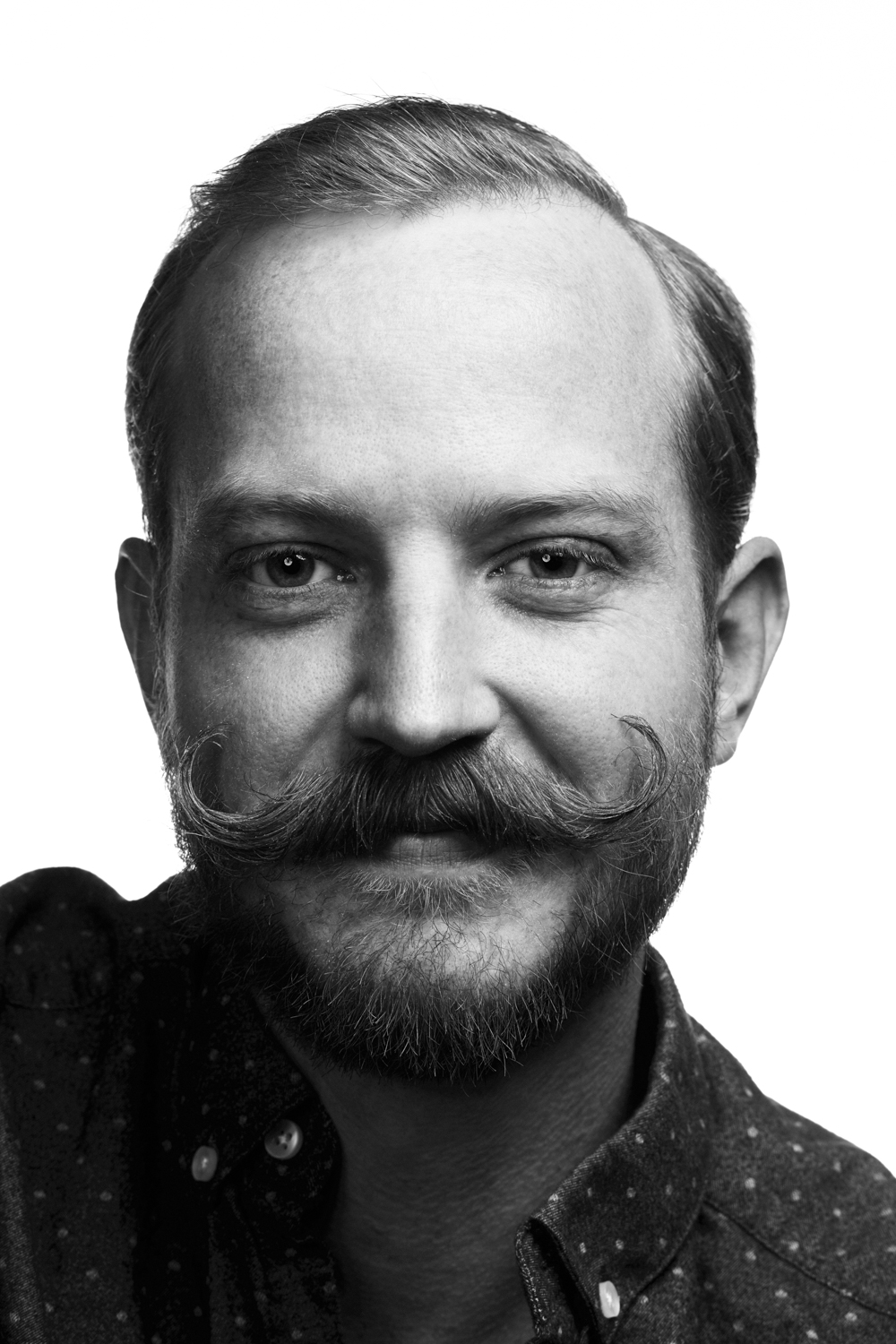 Man on white background, studio photography, black and white portraits, hipster with mustache
