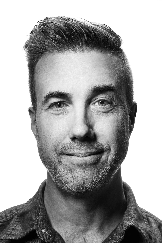 Man on white background, studio photography, black and white portraits