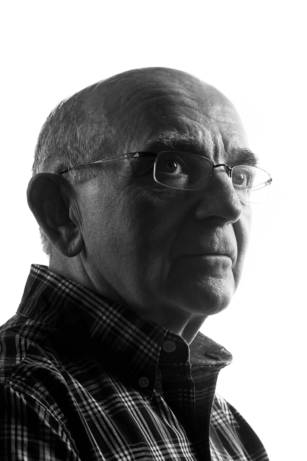 Man on white background, studio photography, black and white portraits, older man with glasses