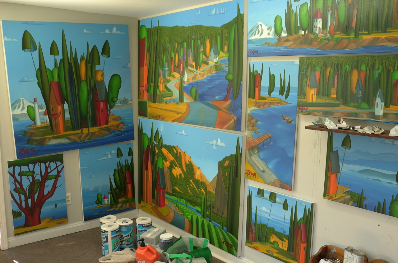 """Photos from the """"old"""" Mayne Island """"shed"""": a 9'x14' studio with a 7' ceiling. As I prepared for my Aug 2012 exhibit on Mayne Island, my """"new"""" studio was being built, thus my drying work had to be squished onto the walls here. Hence, note the diminishing wall space."""