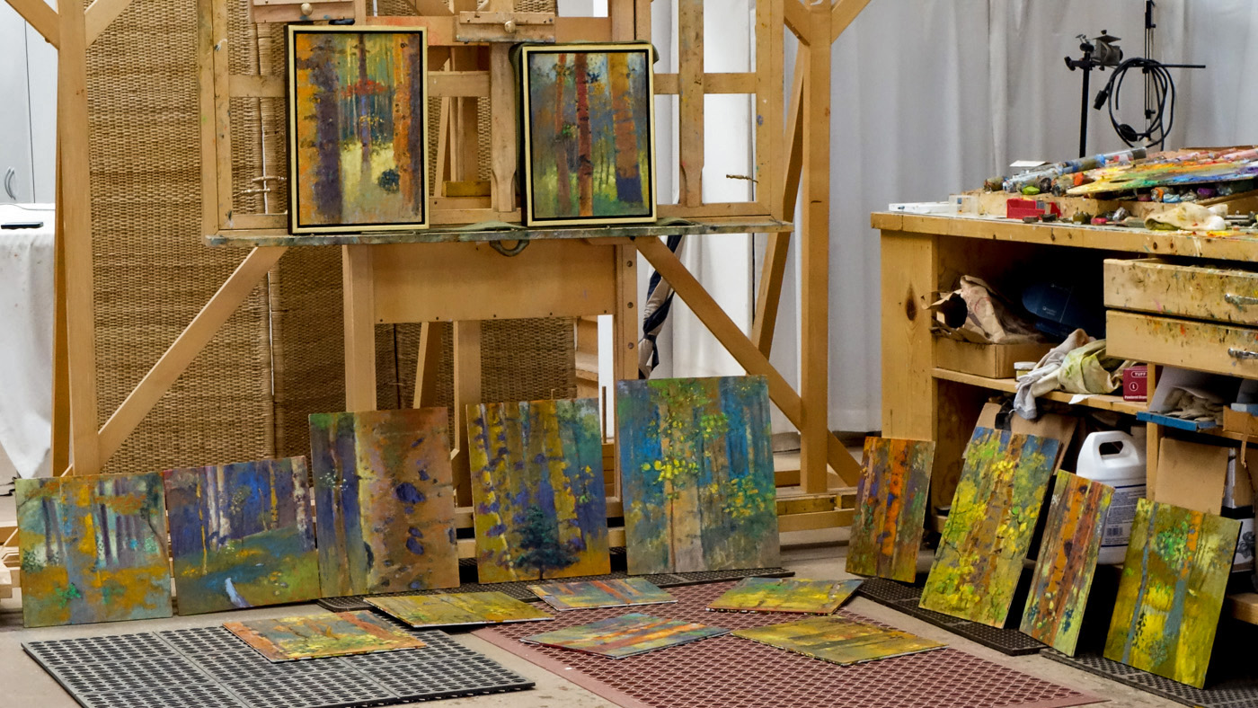 paintings in various states of the process at the studio