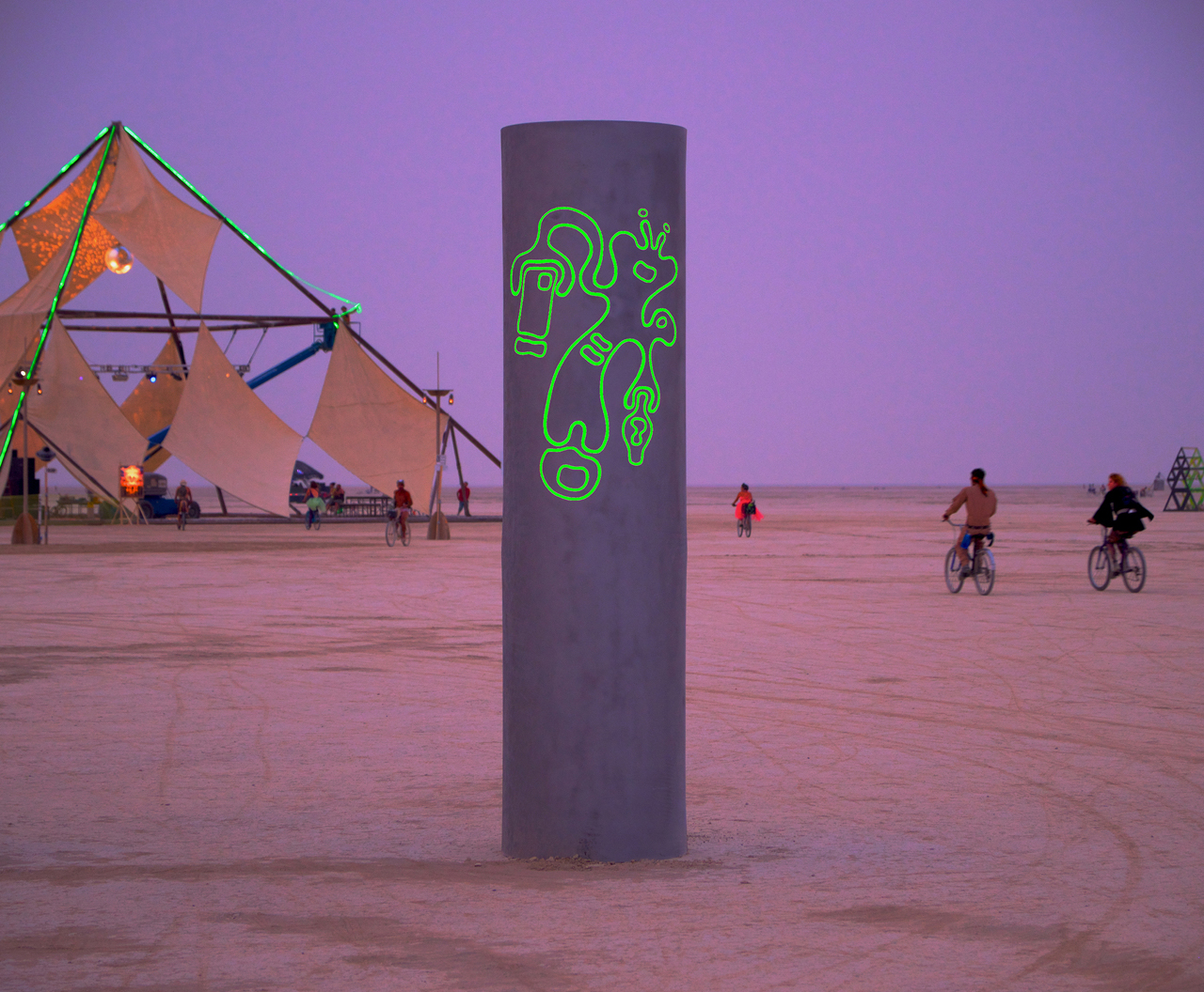 At Burning Man 2013 the color was a nickel silver to go along with that year's theme of Cargo Cult. We were happy with them and they looked awesome, but our new darker color allows the image stand out more during the day.