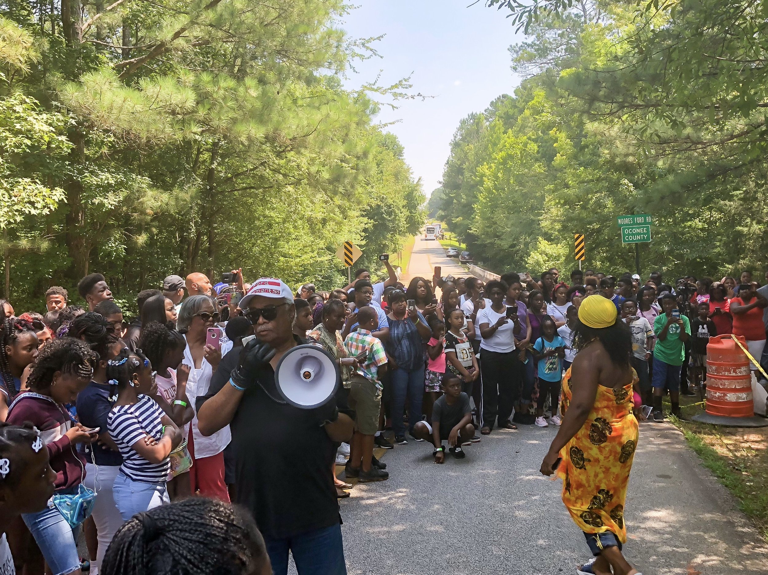 200 students from surrounding southern states visit the location of the Moore's Ford Lynching to watch an abbreviated version of the annual lynching re-enactment one day before the annual event. Tyrone Brooks leads the event.