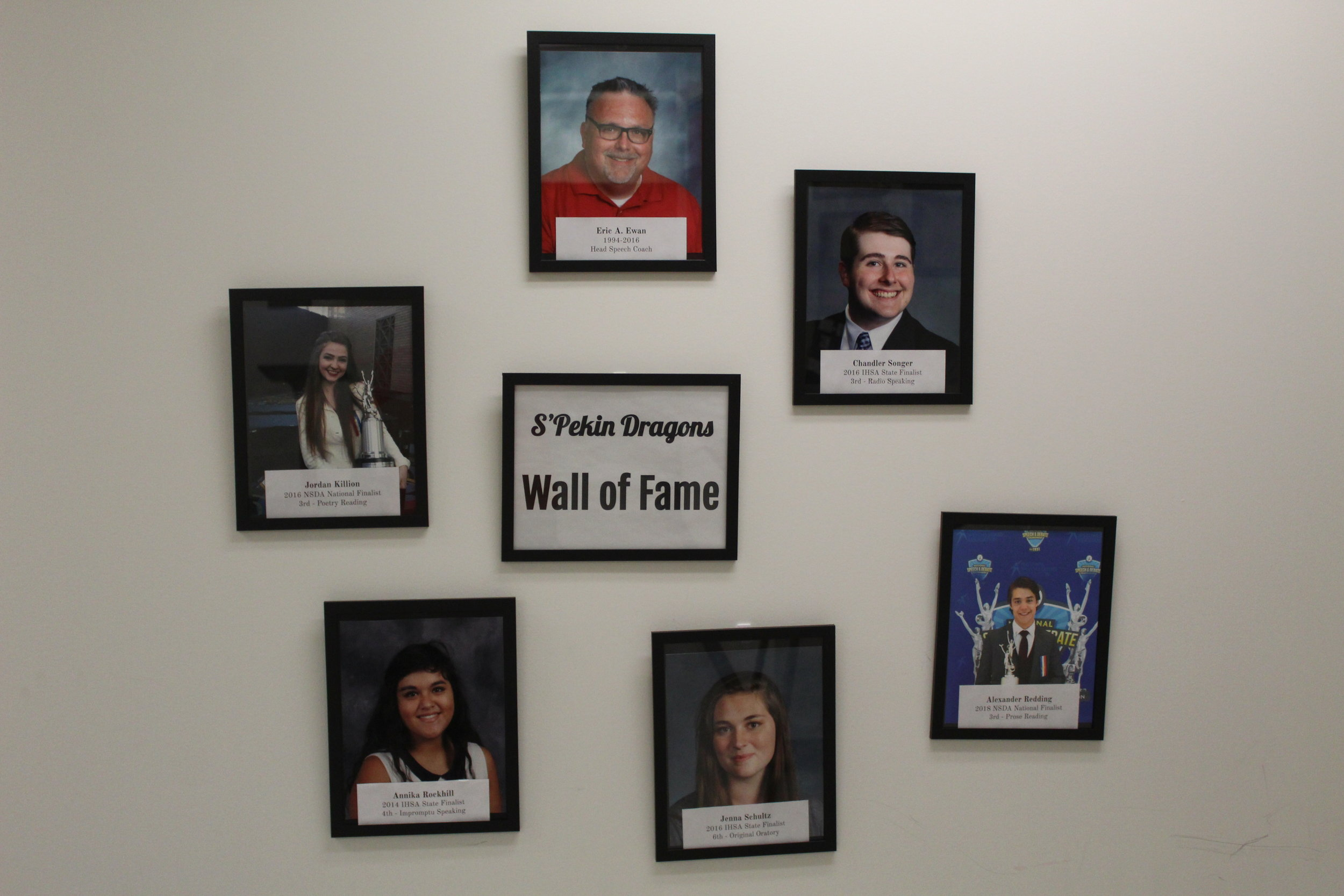 The Wall of Fame can be found in Mr. Pyles room. The wall is a new addition to the team this year and includes many successful alumni including… Mr. Eric Ewan (top), Jordan Killion (top left), Annika Rockhill (bottom left), Jenna Schultz (bottom), Alexander Redding (bottom right), and Chandler Songer (top right)