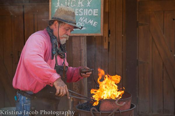 A blacksmith prepares a horseshoe for customization