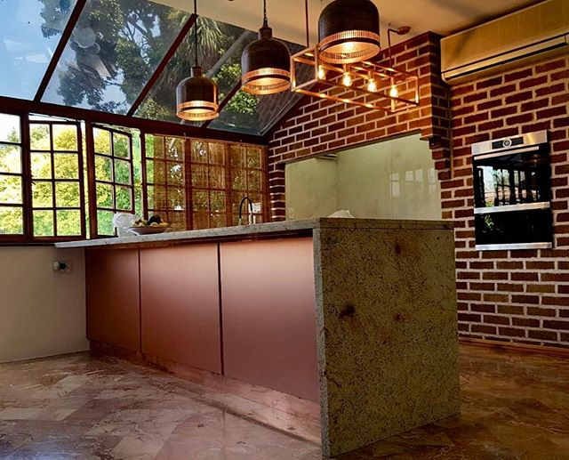 Spectacular island with copper paneling from @niemannsa custom designed copper kick plates, all enhanced by the perfectly matched lighting chosen by client and beautiful natural light coming through- so inviting!  #localzadesign #kitchenremodel #joburgstyle #designjoburg