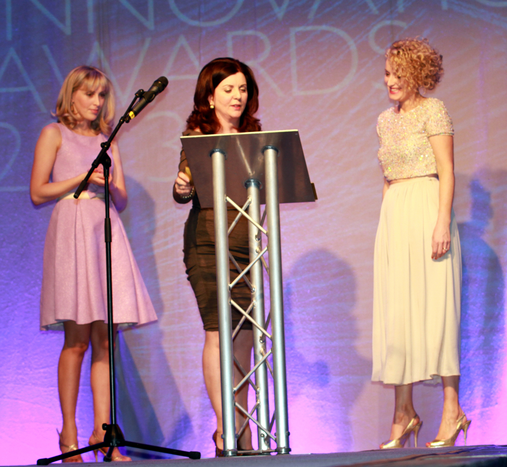 """Designer Heidi Higgins and Golden Egg Productions Managing Director Patricia McCrossan presenting me with the """"Red Caret Award"""" at last years Fashion Innovation Awards."""