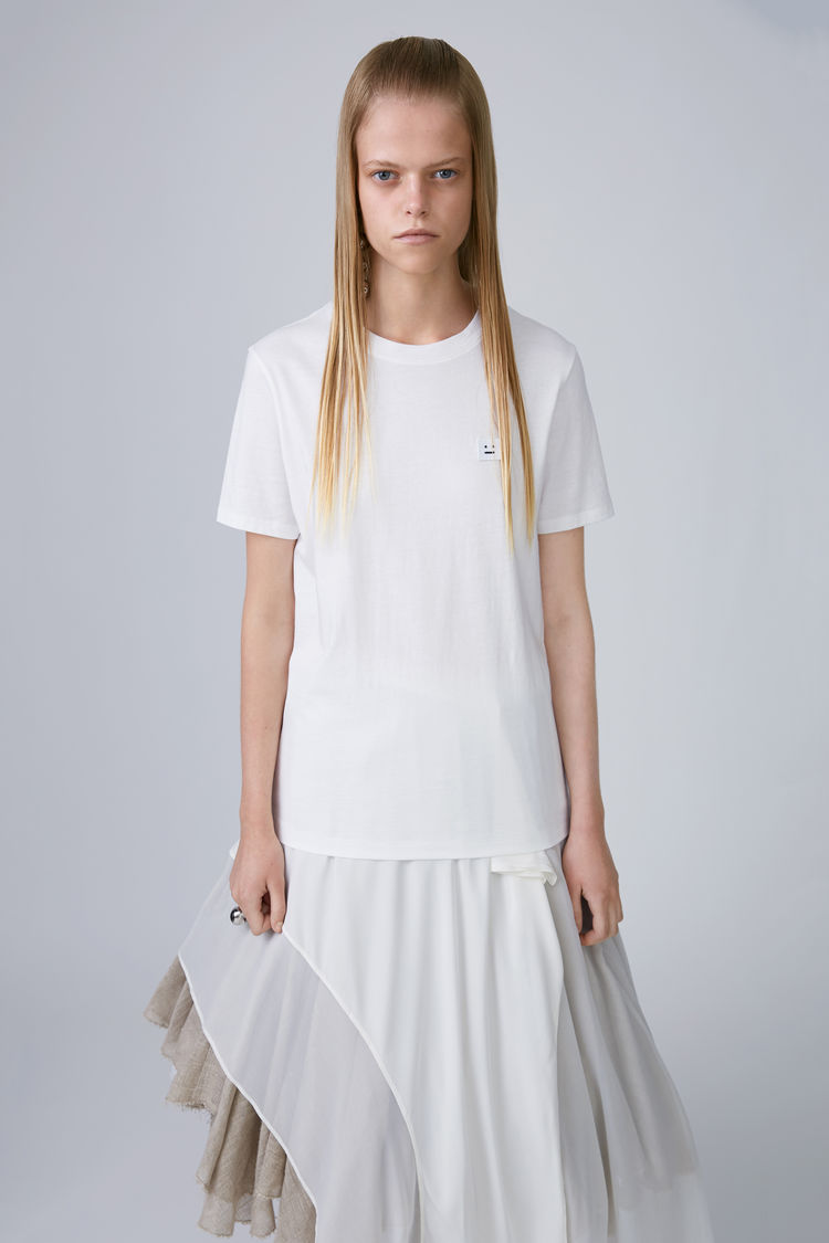 White Tee   This is definitely a wardrobe essential for SS whether it's a round neck or a v neck everyone needs a good white tee. Almost every label will have their own version of the white tee. I chose an Acne tee as the quality and shape are just perfect for me. Alexander Wang, Marks & Spencers and Oasis are also favourites. They are perfect with pretty much everything. The most important thing for a white tee, is that it remains super white.  Click here  for link.  http://lesjumelles.ie/