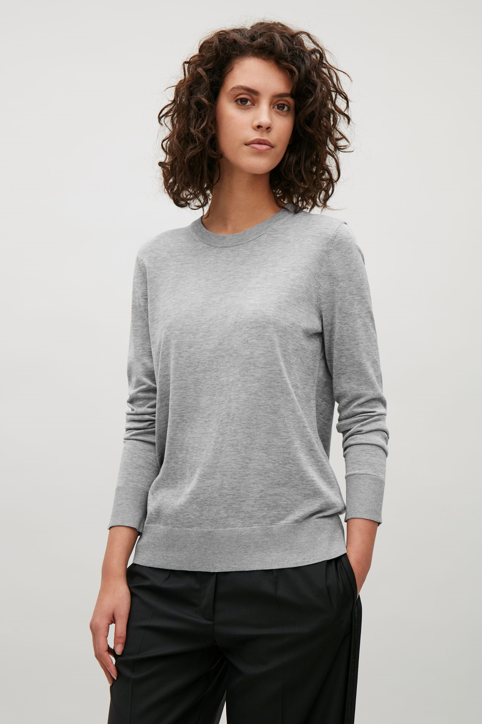 Cotton Silk Knits     These knits (both grey and navy) are such a good buy. At €69 each is impossible to find another label that can compete on quality and fit. They work with so much. It looks great layered with a white shirt but it also looks great on its own. It can be worn tucked in to high waisted trousers or skirts. It can also just be worn casually with jeans. I would recommend going down a size. I'm size XS in it.