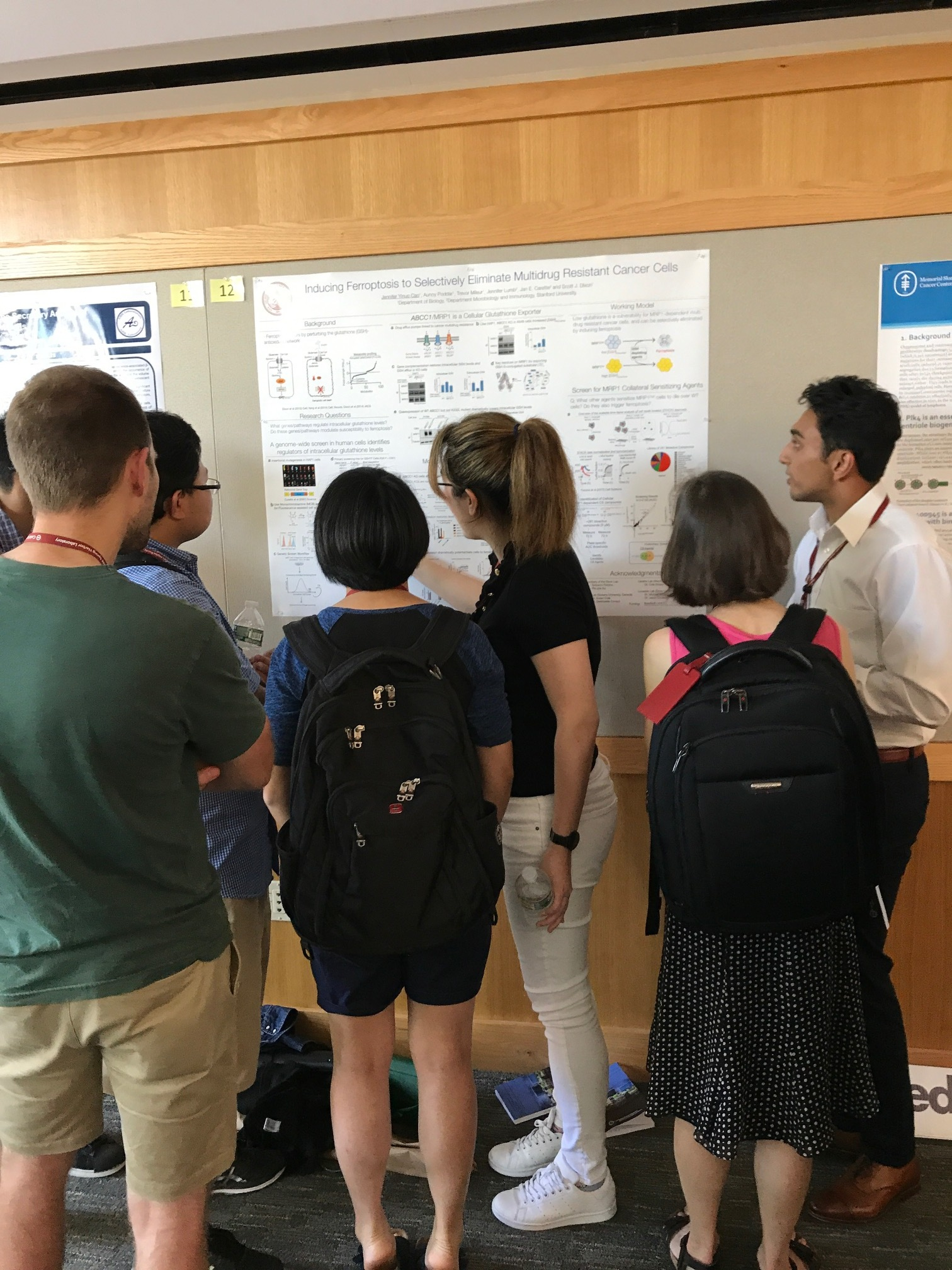 Jen explains her work. Aunoy looks on. - CSHL Cell Death Meeting, 16 Aug 2017