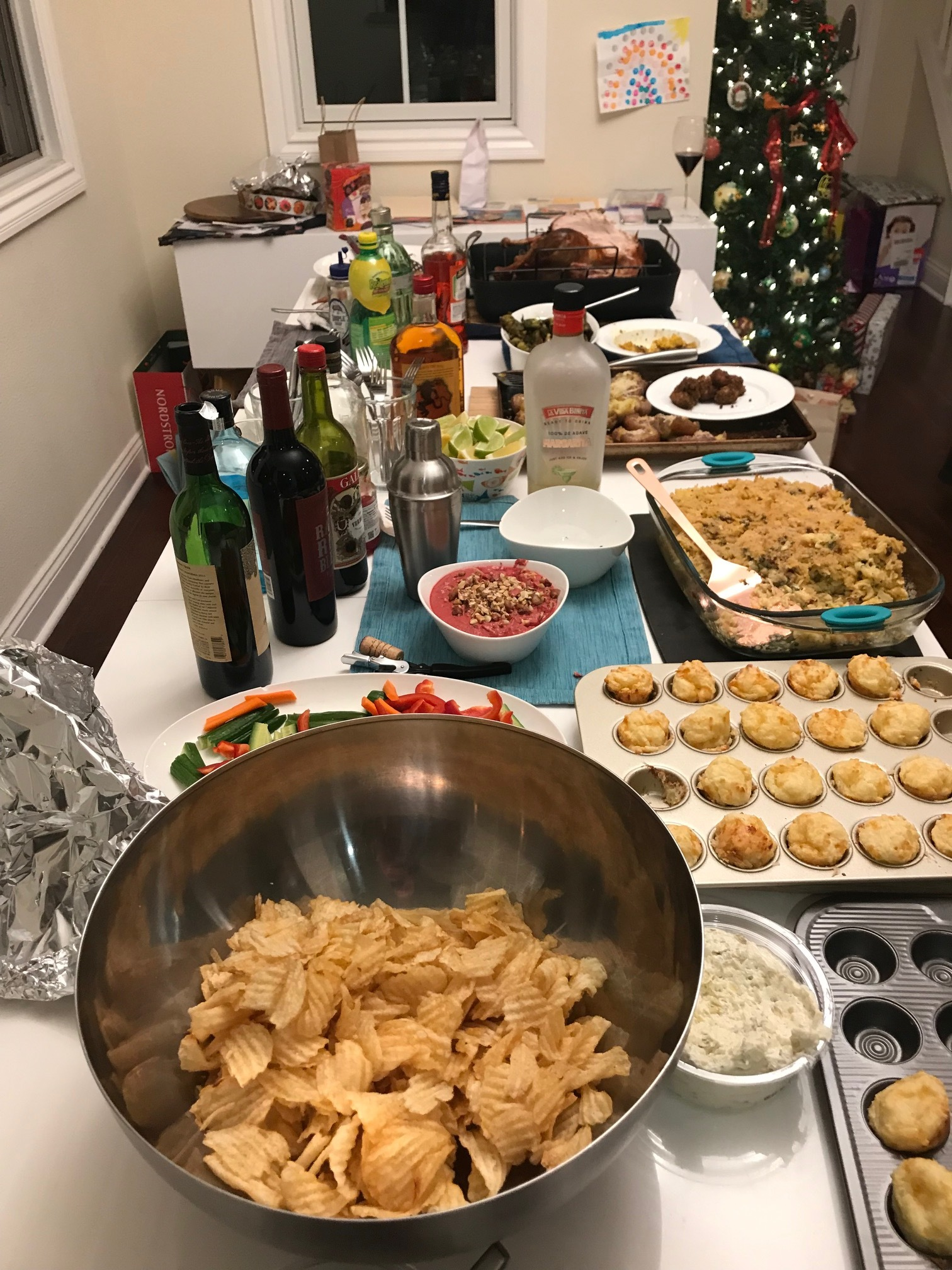 Lab holiday party spread. Chips being prominent.  - 15 Dec 18