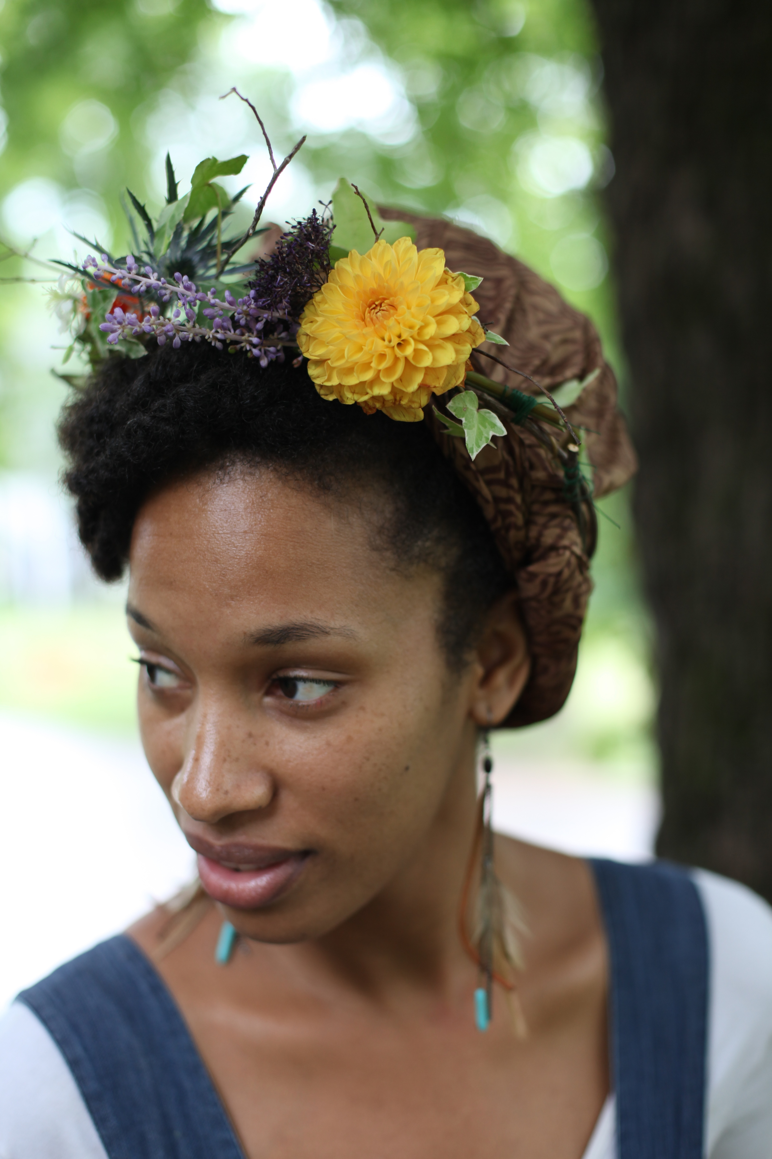 Ayesha of  Homespun  showing off the dahlia in her topper