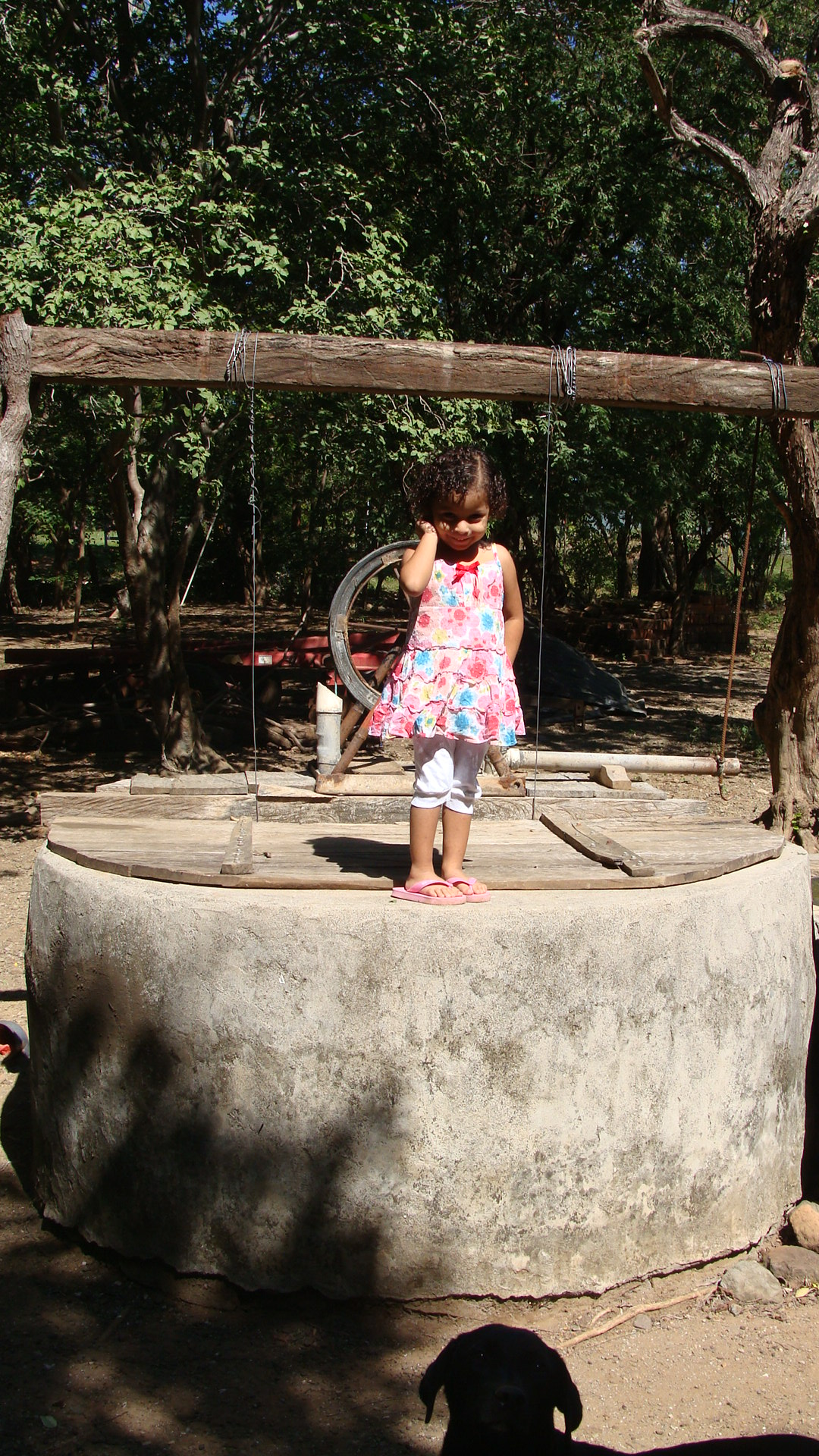 Little girl at Project Limón standing on the Well Project Adopted by University of Minnesota in 2011-2012.