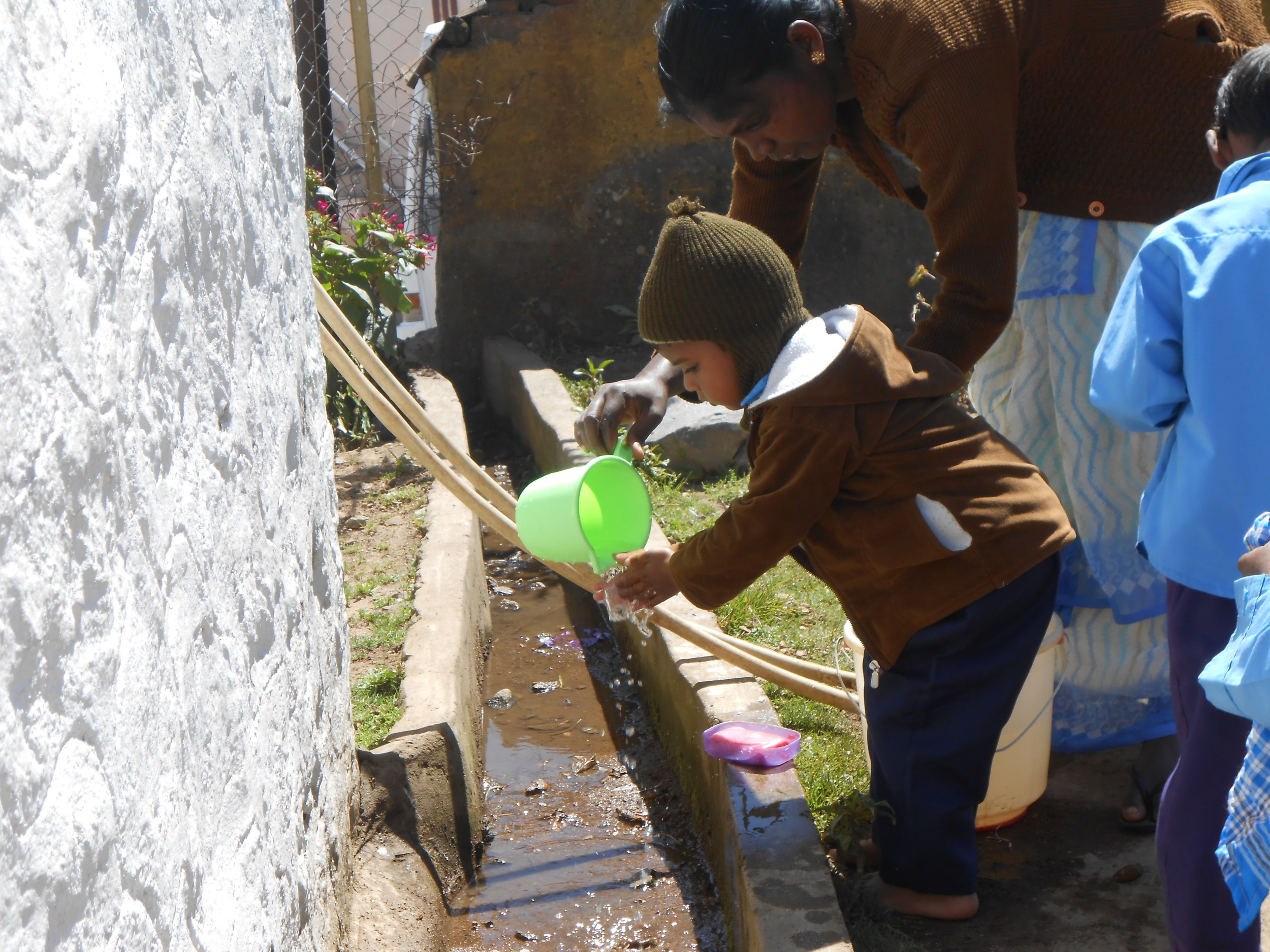 Little boy at Project Kodaikanal during a hand washing health education lesson!