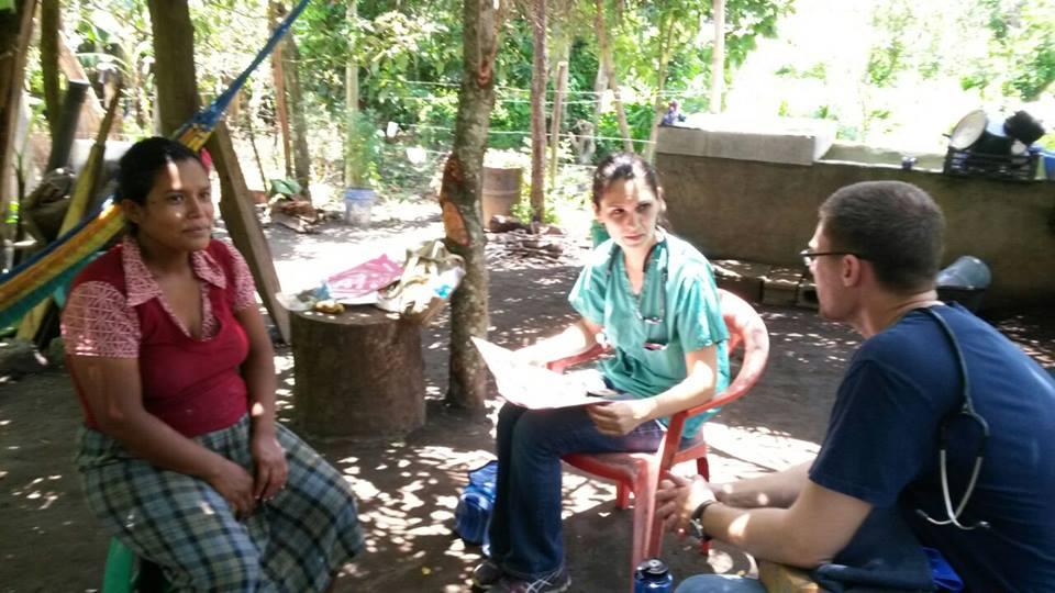 Volunteers at Project Las Delicias conducting a home visit