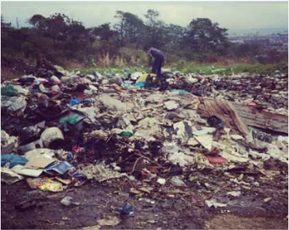 One person's trash is another's treasure: A man searches through disposed items for anything that may be of use to him