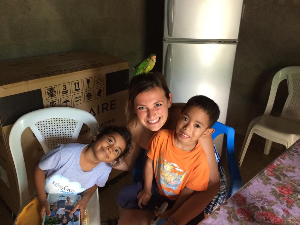 Sam spending time with her homestay family and pet parakeet!