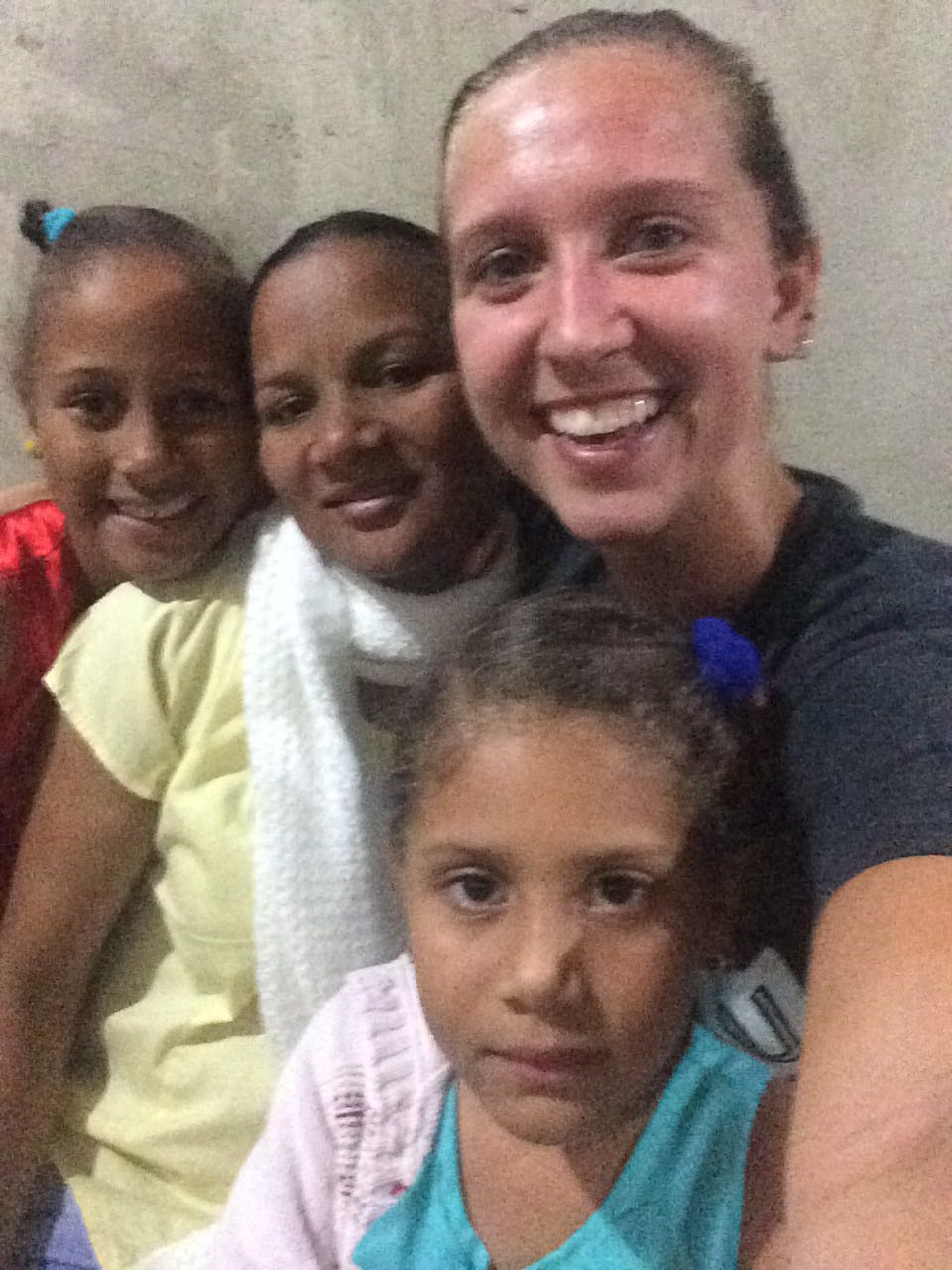 Lots of hugs for long-term volunteer JJ, pictured with her host sisters.