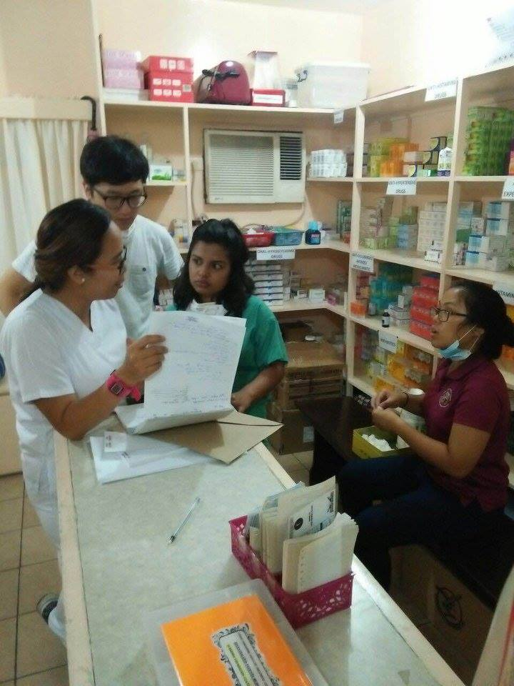 SIHF Philippines  Fellows assist in the pharmacy at the Canossa Health Center in Manila.