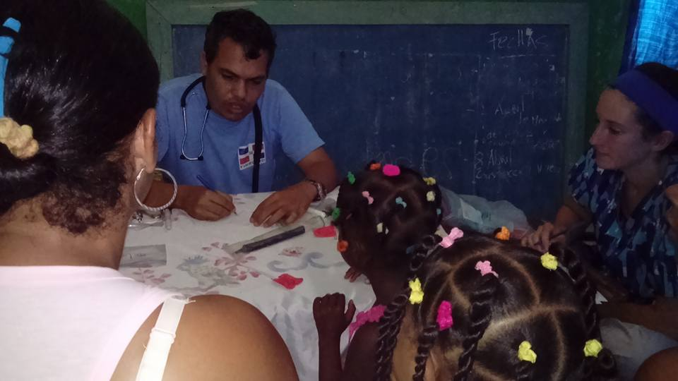 SIHF Dominican Republic  Fellow Emilie sits it on a patient consultation with Dr. Ricardo.