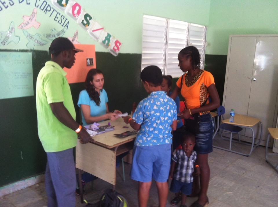 SIHF Dominican Republic  Field Operations Manager, Gina, welcomes participants to a community health fair.