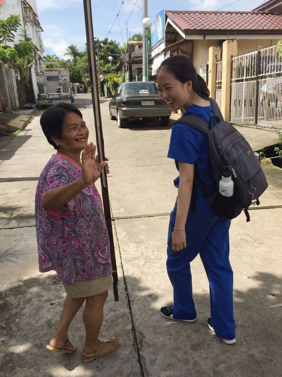 SIHF Philippines  Fellow Christin assisting with house-to-house PhilPen screenings.