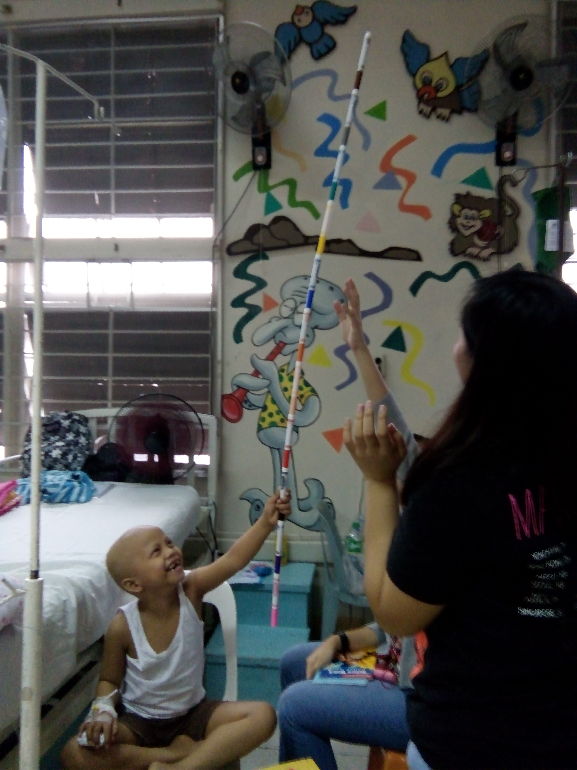 SIHF Philippines  Fellows spend time with the children at the UP Cancer Institute.