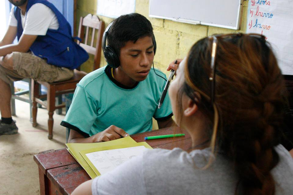 SIHF La Merced, Peru  Fellows administer an auditory test.