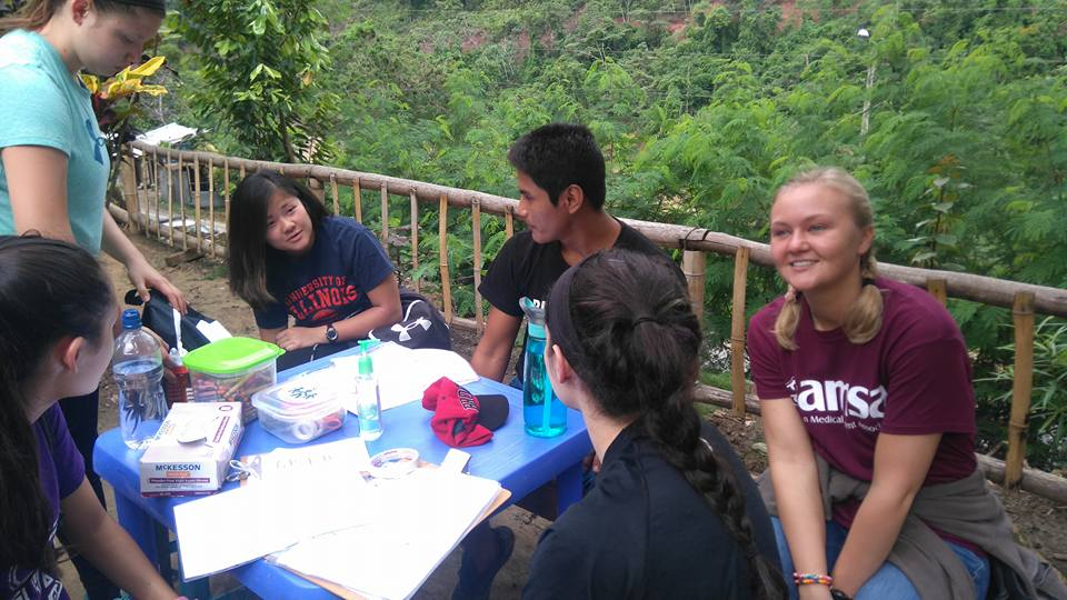 Volunteers working a station...and attempting to perfect their Spanish!