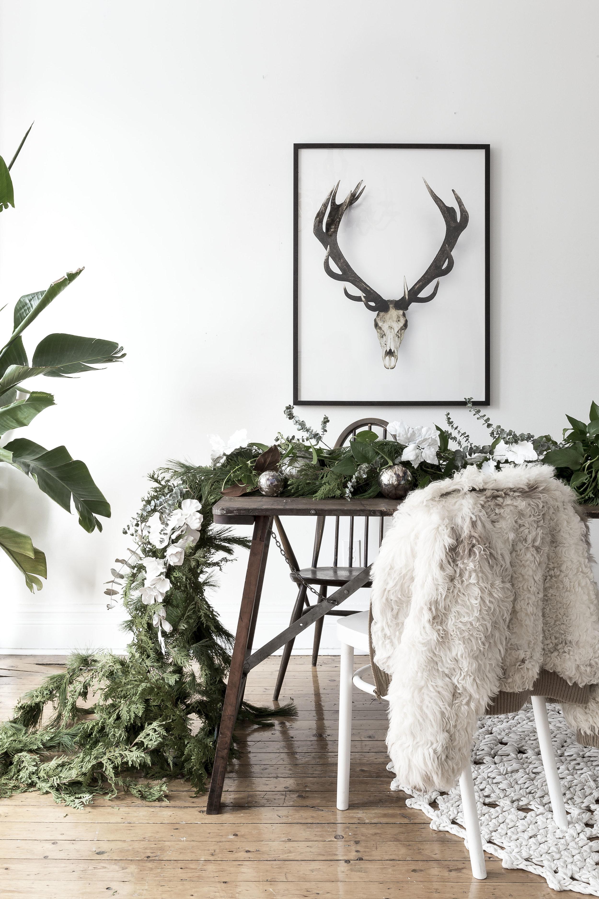Styled Christmas table setting. Artwork  Oh Deer