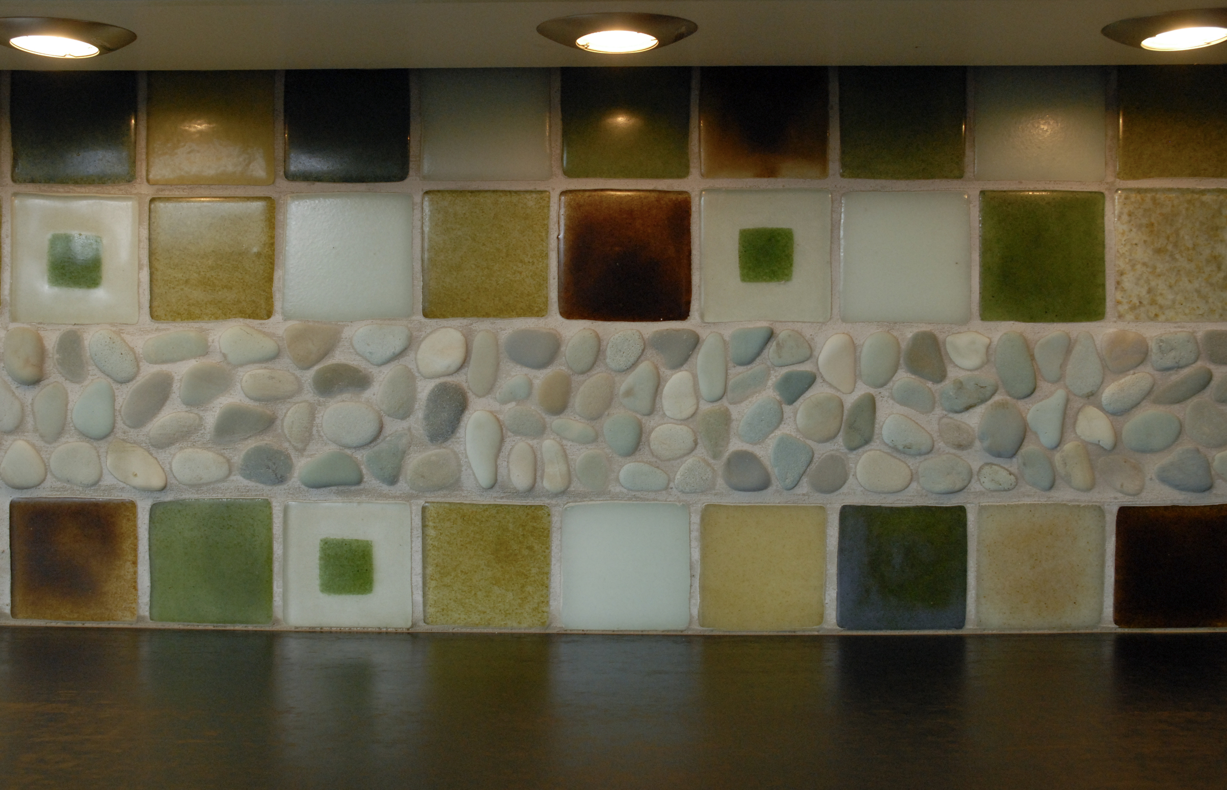 "Recycled glass tile and ""paperstone"" countertops reflects an eco-friendly design ethic"