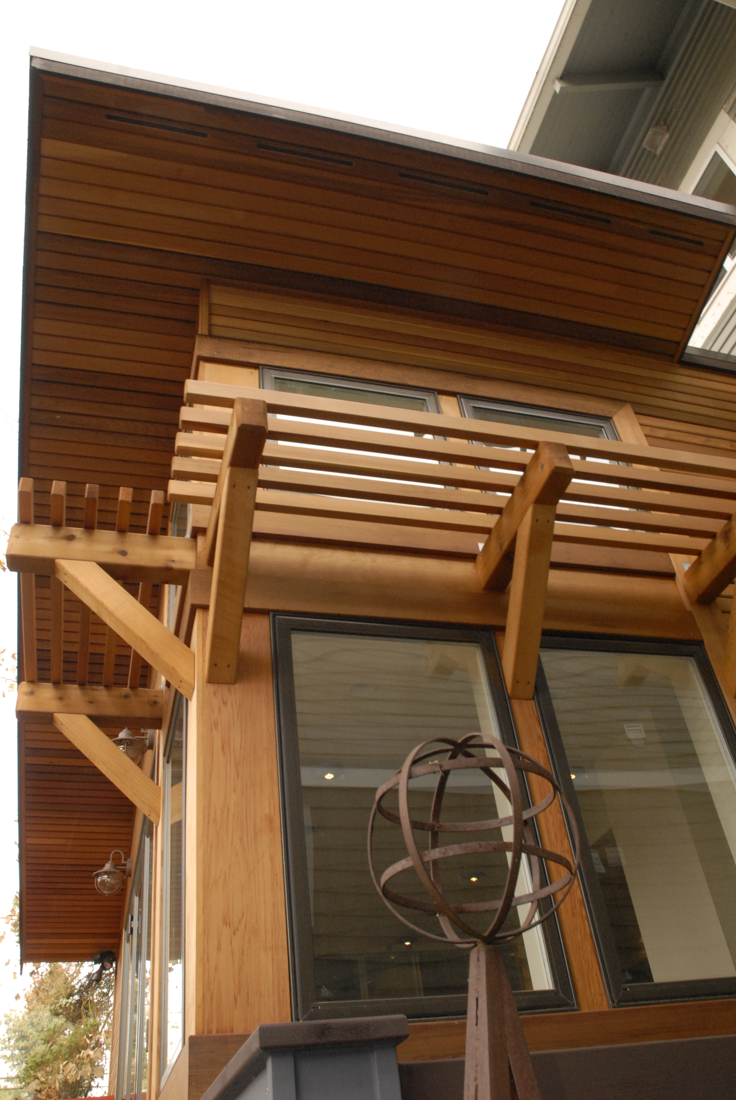 Wide overhangs with tongue and groove soffits and custom cedar awnings