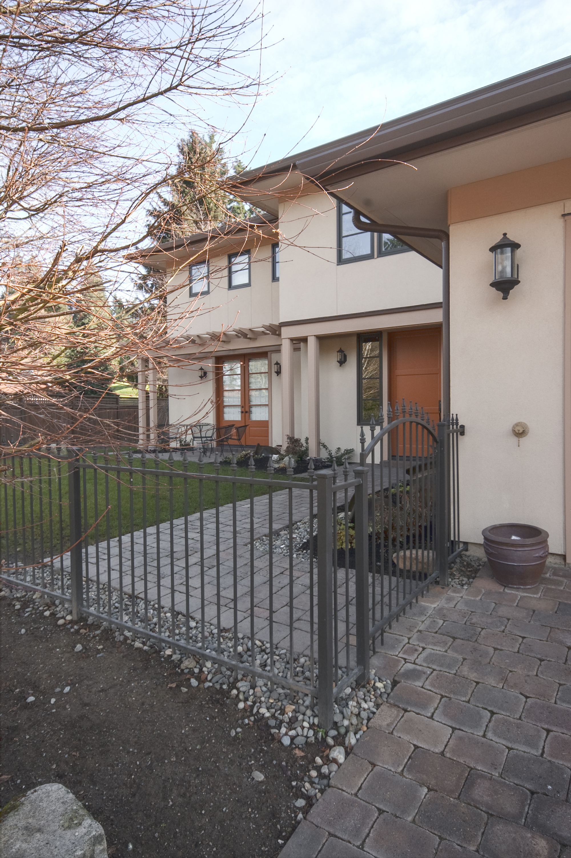Original custom iron fence was modified and added onto to fit the new yard configuration.