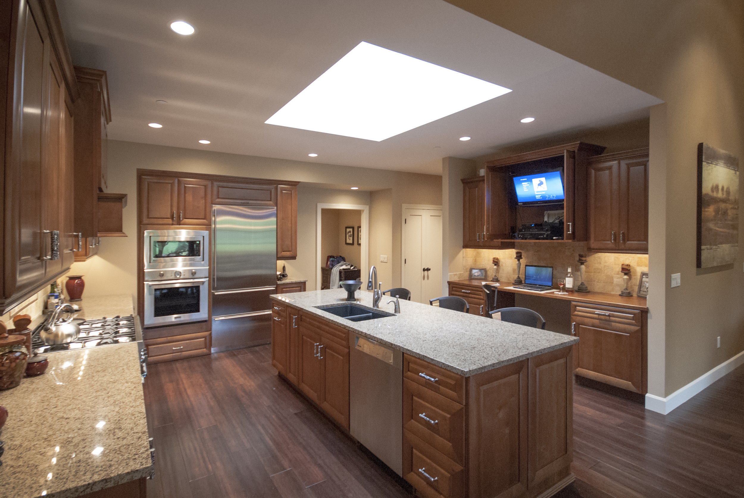The center cabinet houses a TV and media center.  A cool feature is the slide away cabinet doors, which tuck away in the cabinet.