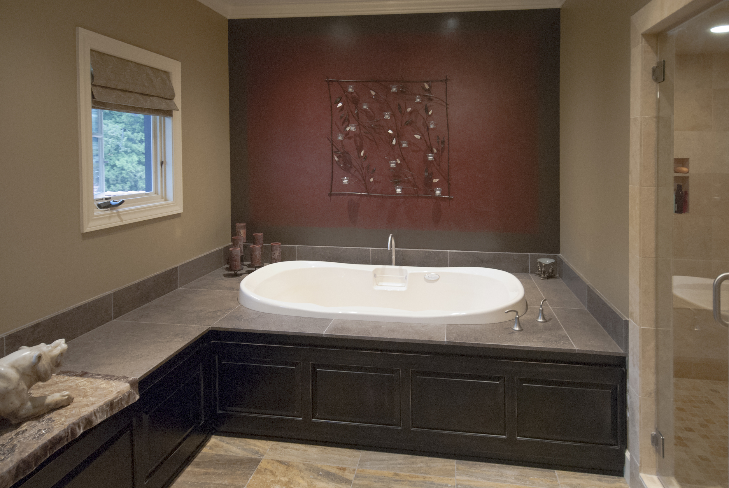 The client is a talented painter and did a lovely job faux finishing the wall behind her champaign bubble tub which includes fiber optic color changing lights.