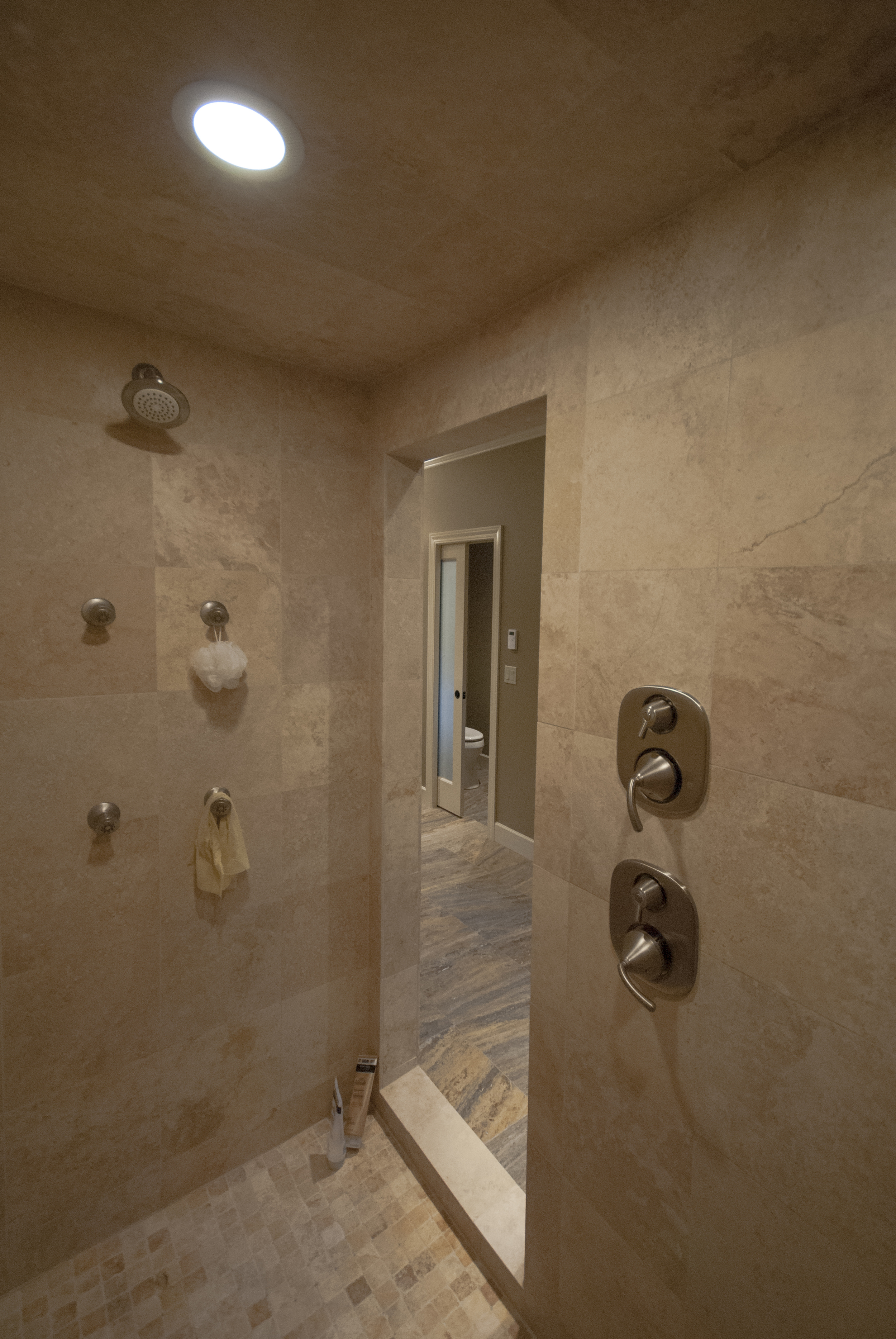 Inside the shower room is body sprays, two shower heads and a hand shower.