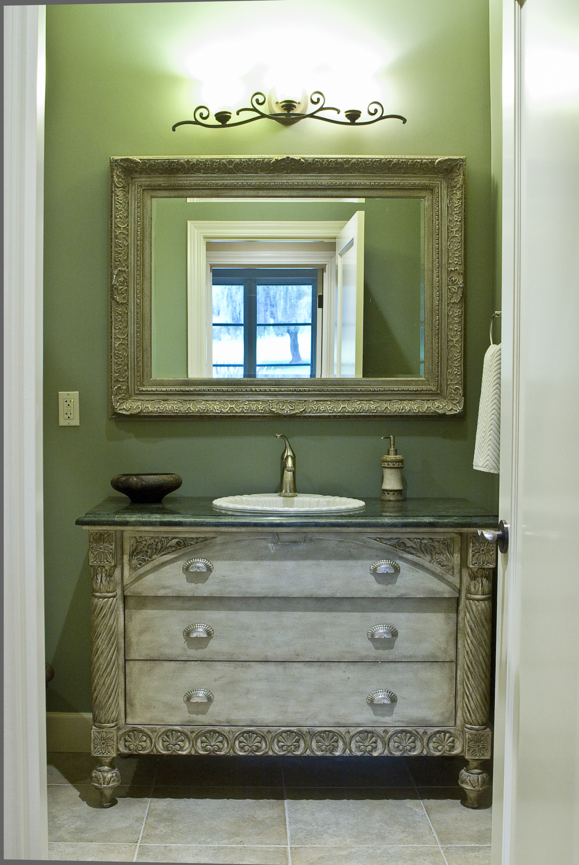 """The """"green bath"""" was our budget bath but you'd never guess it.  The sink base, an old dresser, was refinished by the client."""