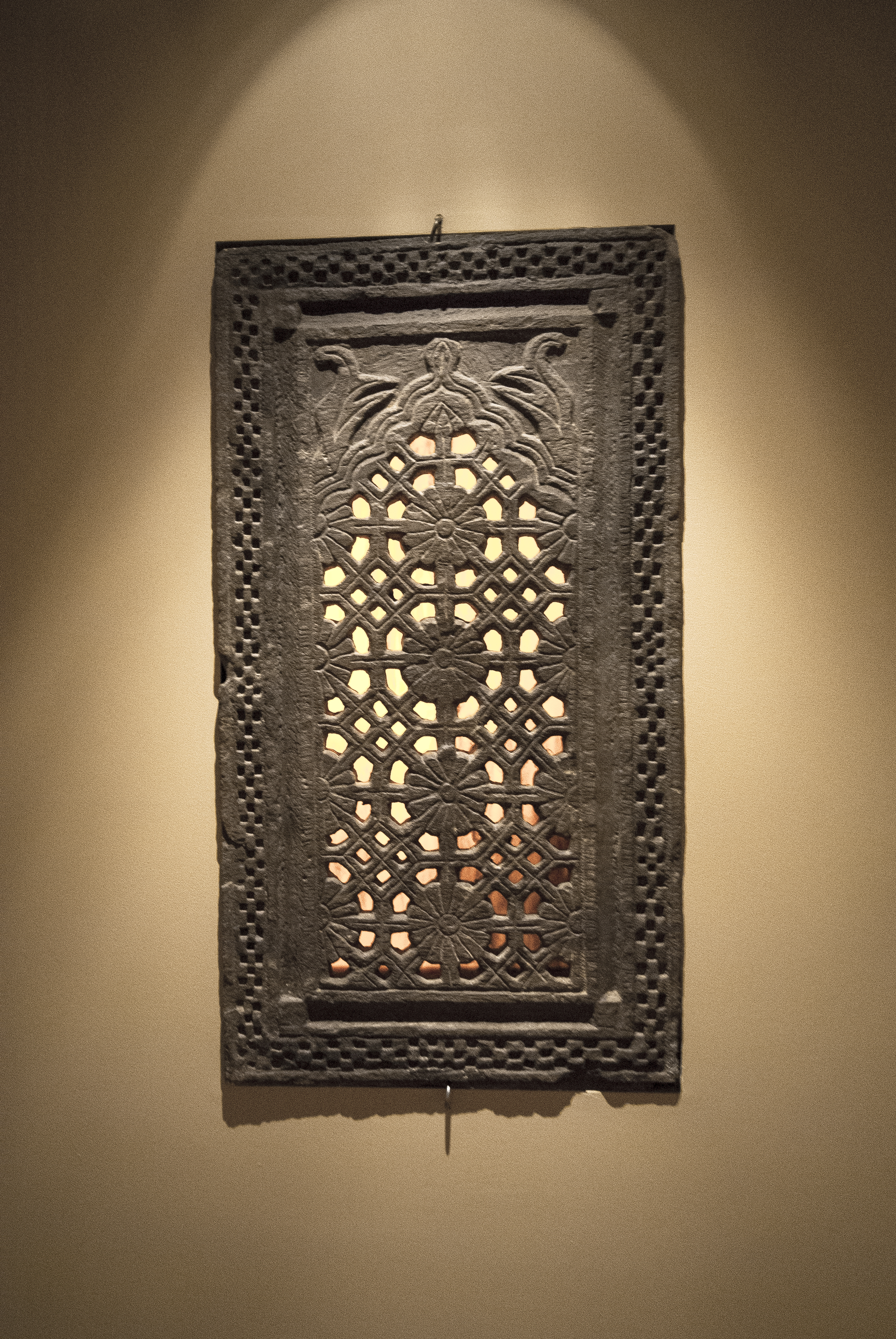"""The """"temple window nook"""" houses an 800 year old window from a Hindu temple.  The window is recessed into the wall and back lit by a Lexan plastic panel."""