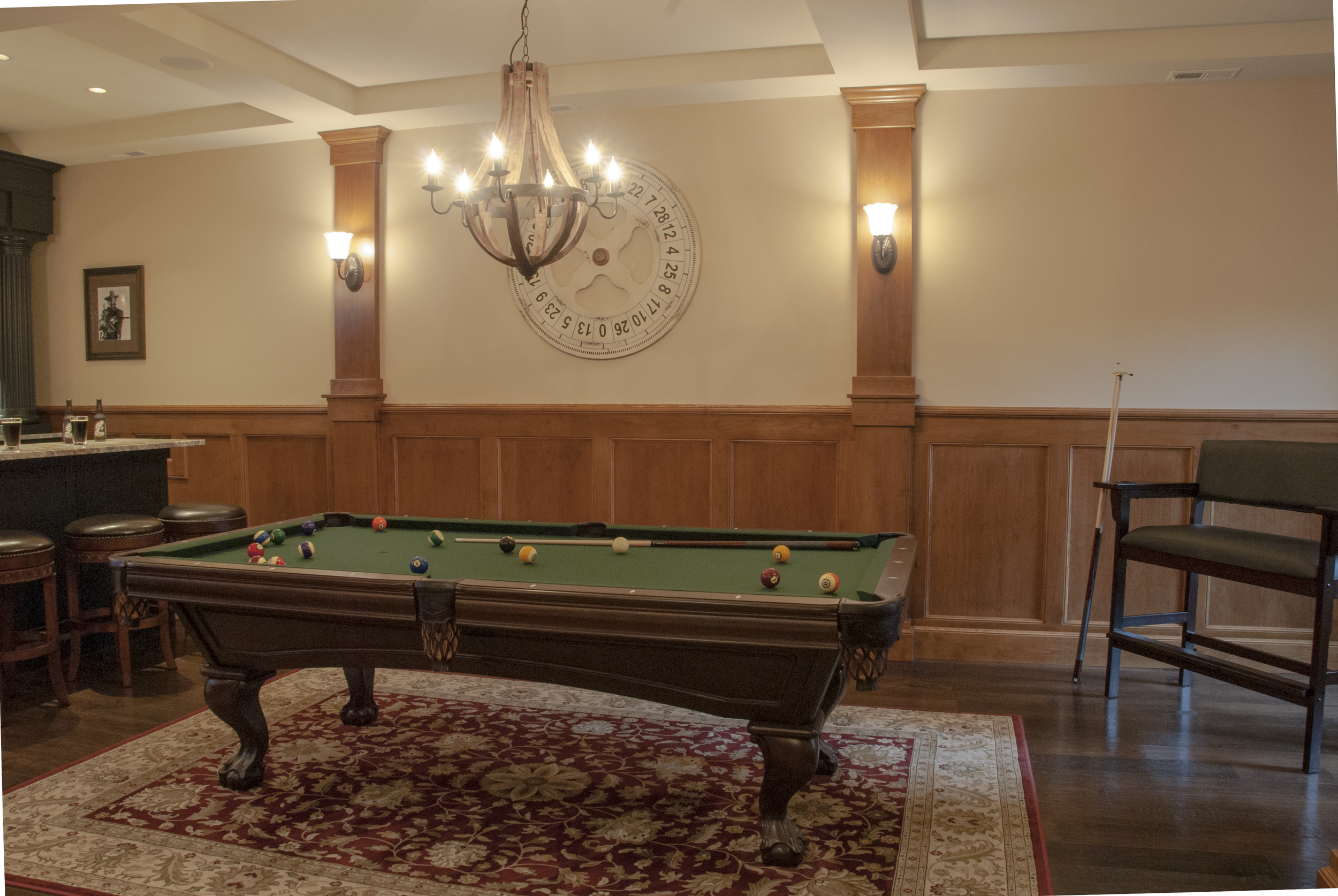 A classic Brunswick walnut club style pool table is one of the central features of the space.