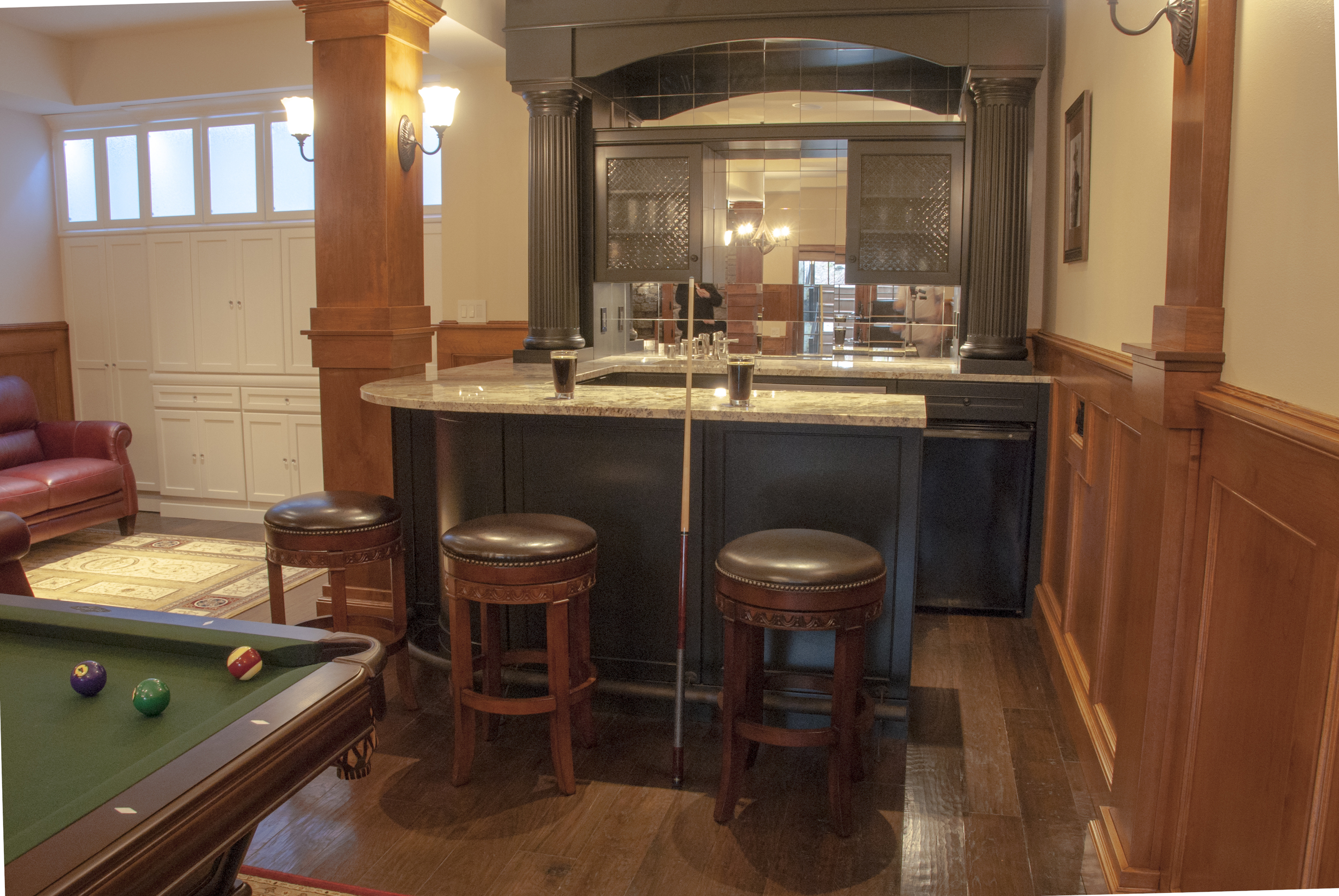 The custom bar - fully stocked of course - is another one of a kind feature which makes this game room into a pub room.