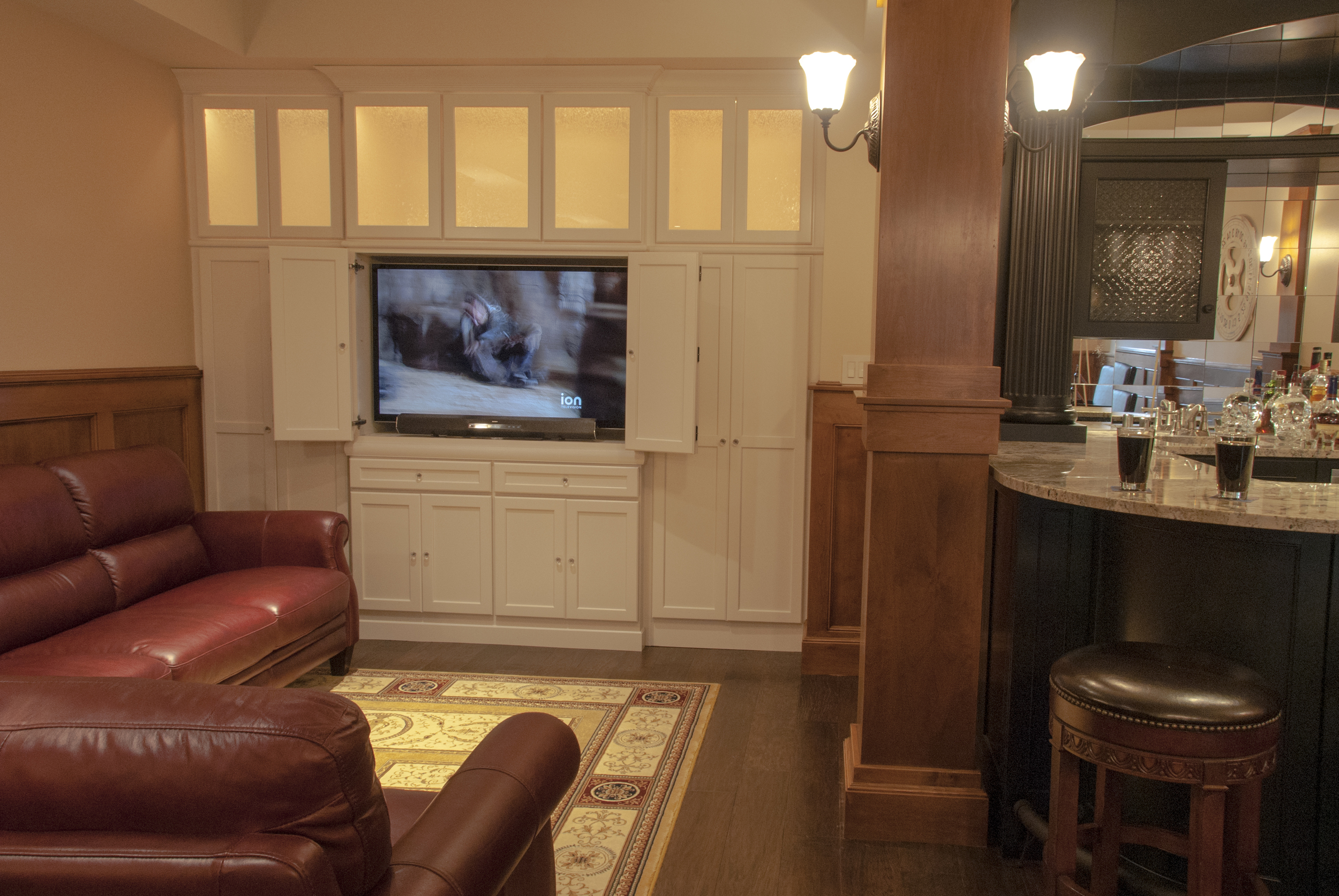 "A 60"" LED TV makes this space the place to be on game day."