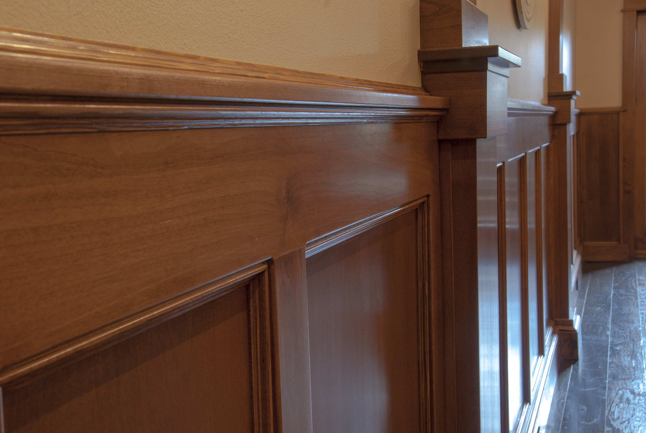 Raised paneling on all the walls assembled on site withhidden fasteners.