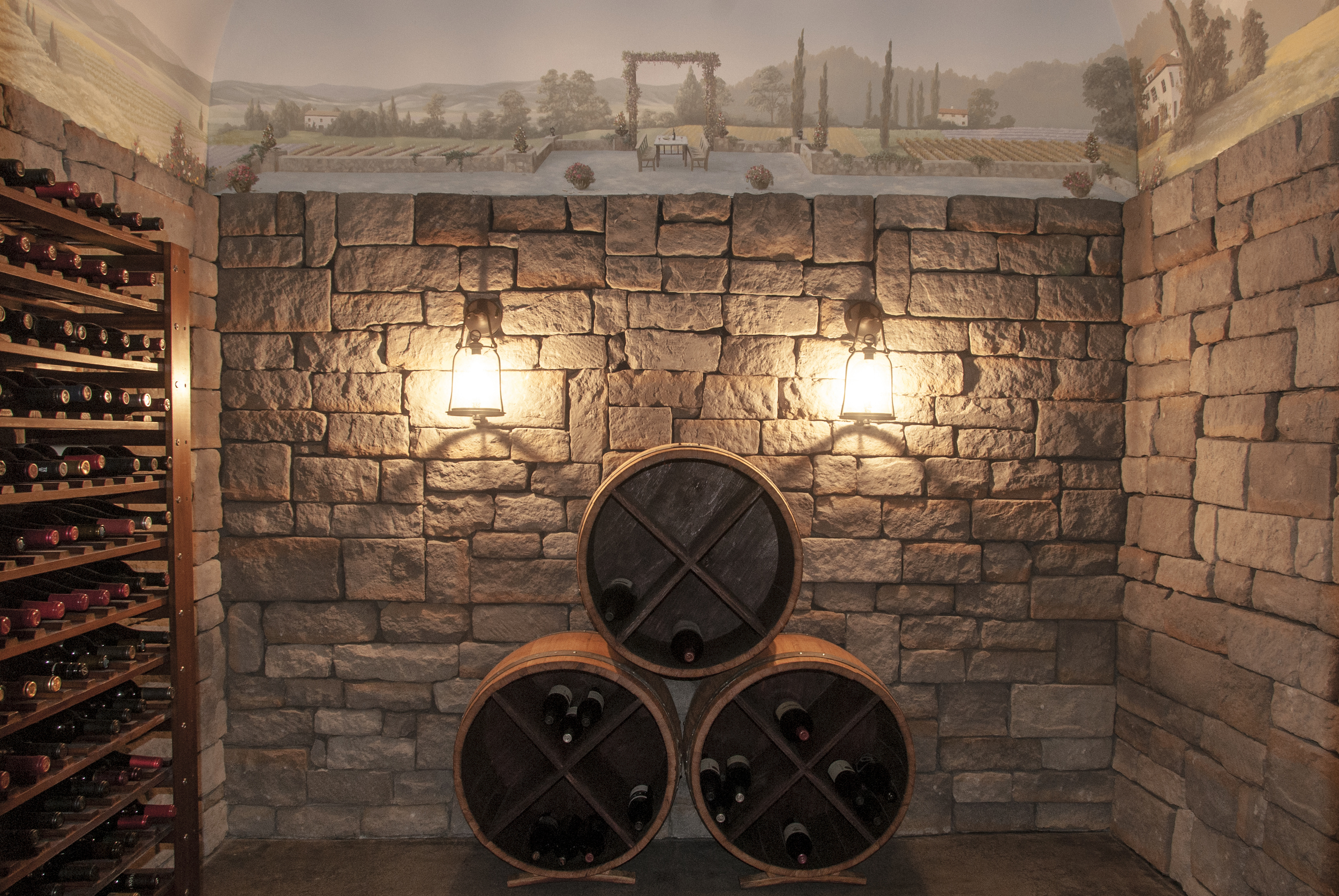 """Real wine barrels make up some of the wine storage and reinforce the """"wine cave"""" atmosphere."""
