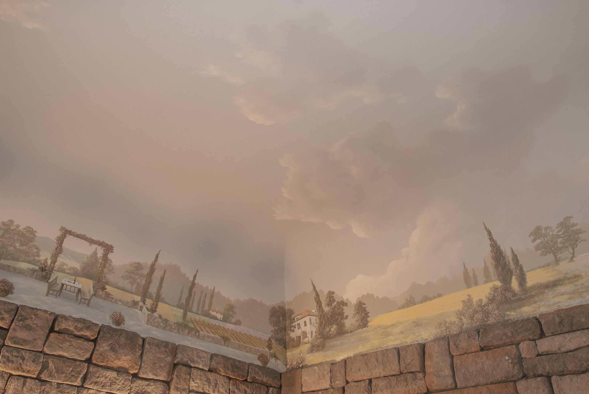 Painted on a traditional plaster domed ceiling the mural is a continuous scene of a Tuscan countryside.