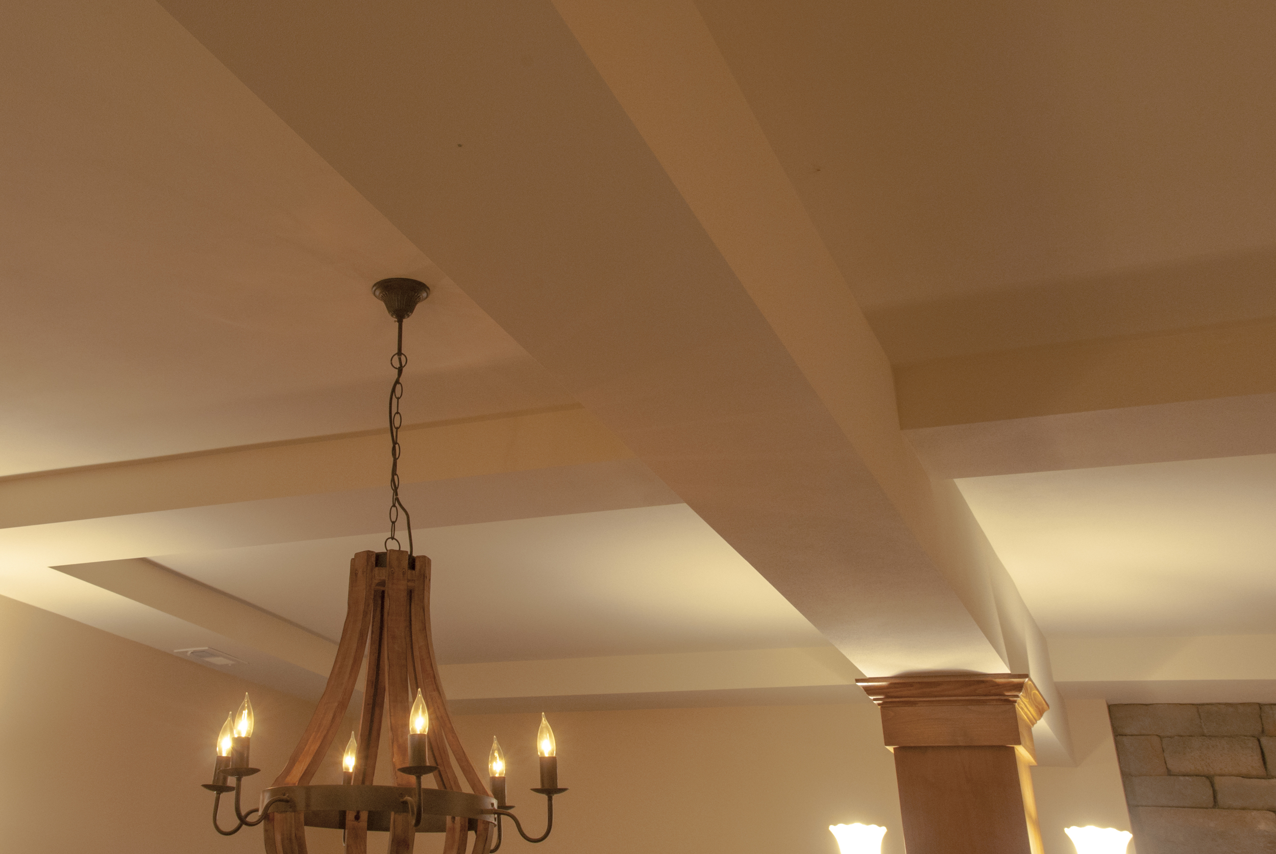 A coffered ceiling both hides the structural beams and adds drama to the 10' ceilings.