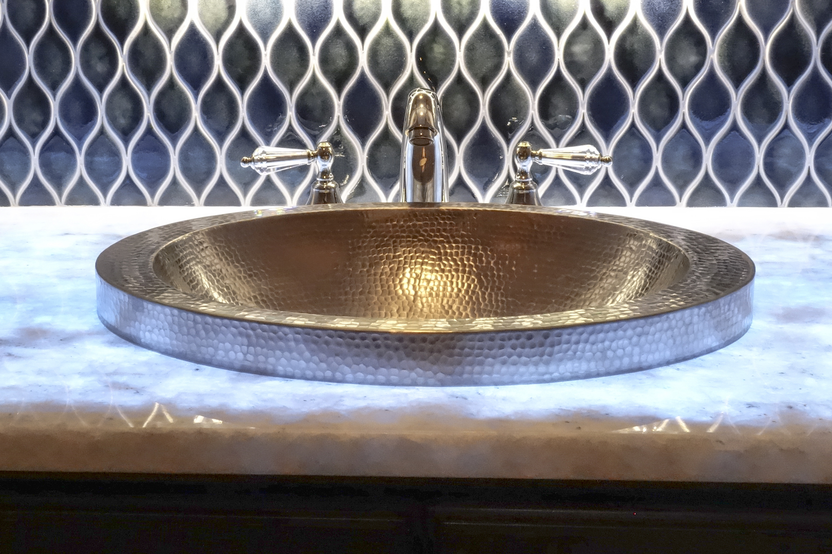 And a handmade hammered copper nickel plated sink...
