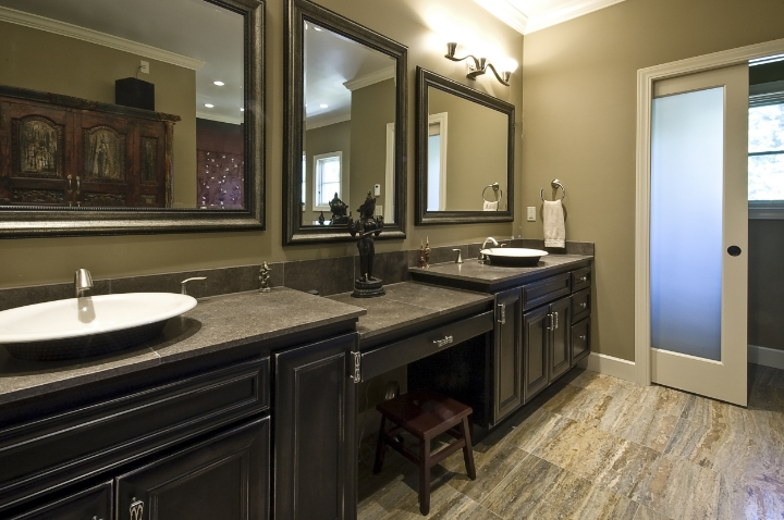 The master bath suite is a very personal place.  Heated floors, his and hers vanities, a make up table and glass doors on the water closet and entry - are just a few things that make this so special.